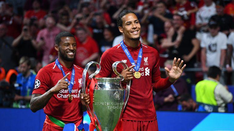 Wijnaldum and Virgil van Dijk pose with the Champions League trophy