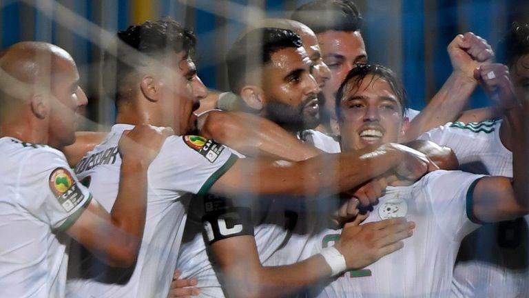 Riyad Mahrez celebrates his strike for Algeria