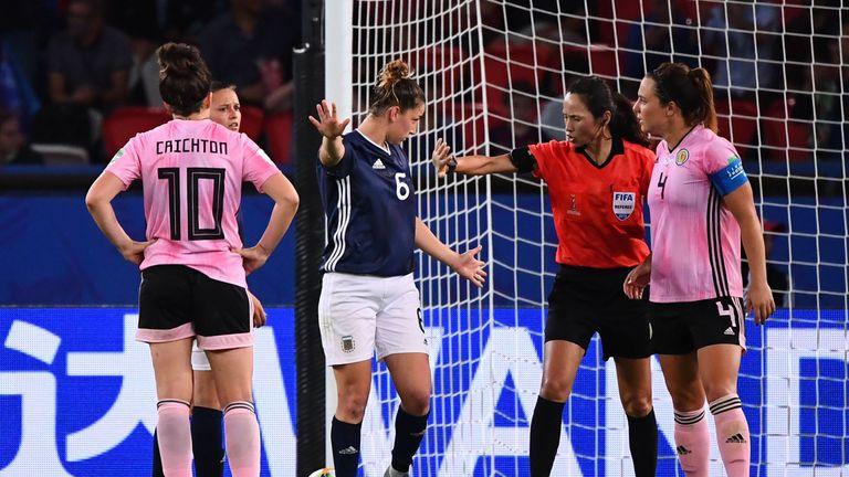 North Korean referee Ri Hyang-ok consults VAR before awarding the late spot-kick