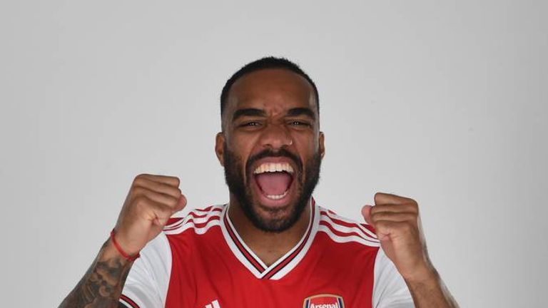 Alexandre Lacazette models Arsenal's new home kit. Pic: Stuart MacFarlane / Arsenal