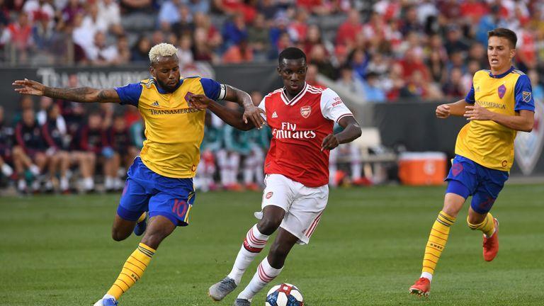Arsenal forward Eddie Nketiah holds off Tyreece John-Jules of Colorado Rapids