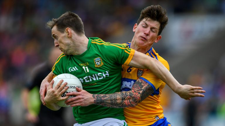 Bryan McMahon of Meath in action against Aaron Fitzgerald of Clare