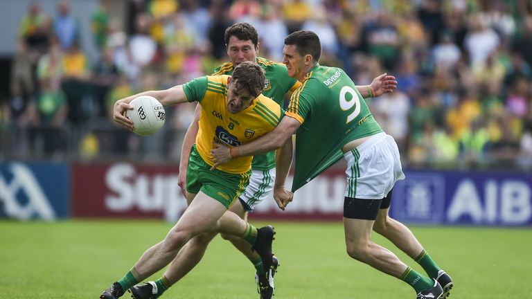 Hugh McFadden of Donegal in action against Shane McEntee of Meath