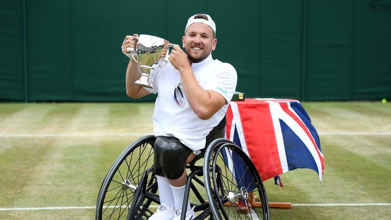 Dylan Alcott celebrates his Wimbledon triumph