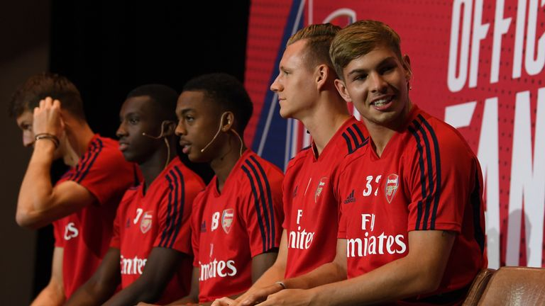 Emile Smith Rowe (right) joins team-mates at a pre-season event