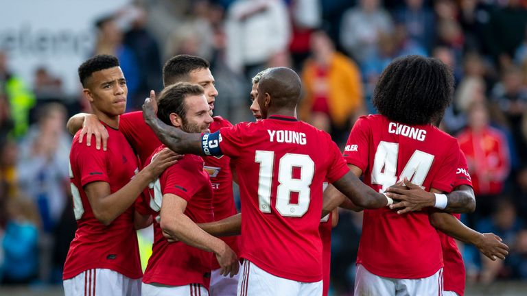 Juan Mata celebrates scoring with Manchester United team-mates against Kristiansund