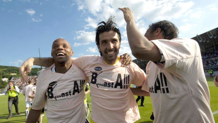 Gianluigi Buffon celebrates with Jean-Alain Boumsong and Jonathan Zebina after Juventus' win at Arezzo sealed their return to Serie A