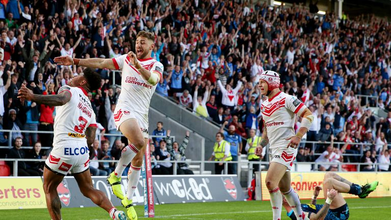 Kevin Maiqama celebrates his try - St Helens' fourth against the Warriors