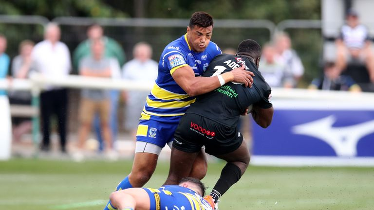 Warrington's Luther Burrell defends against Sadiq Adebiyi
