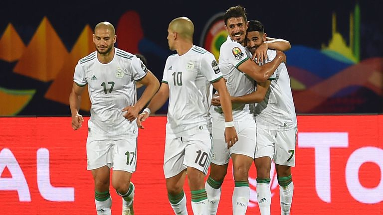 Riyad Mahrez is congratulated after his stunning goal in Algeria's win over Guinea
