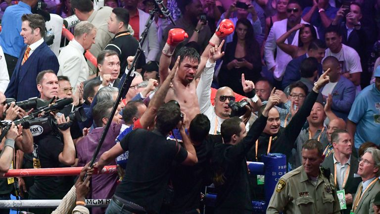 Manny Pacquiao celebrates after becoming the oldest welterweight in history