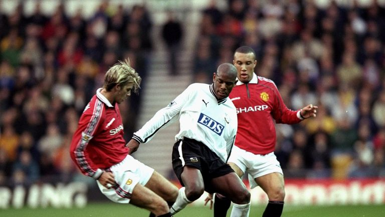 Marvin Robinson in action against Manchester United during his playing days