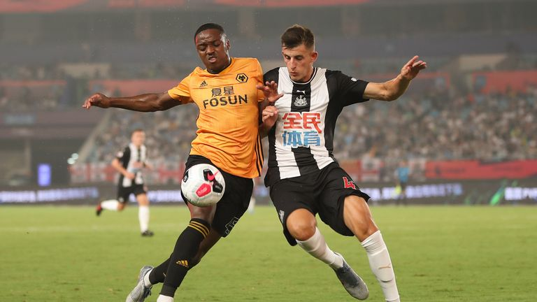 Newcastle's Kelland Watts battles with Niall Ennis during the Premier League Asia Trophy game