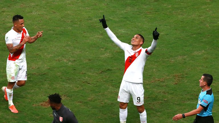 Paolo Guerrero celebrates his goal, Chile's third,  to confirm their final place