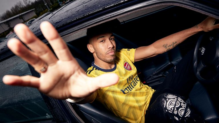 Pierre-Emerick Aubameyang models Arsenal's modern take on their classic 'bruised banana' kit