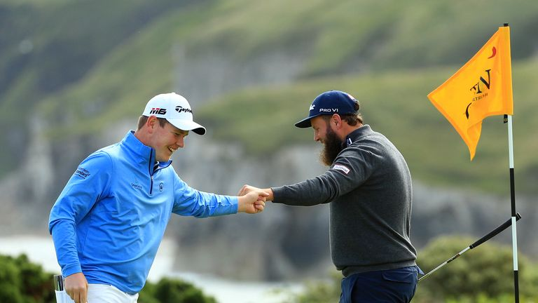 Bob MacIntyre celebrates his eagle at the fifth with Andrew Johnston during the first round
