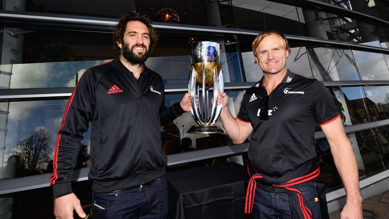Captain Samuel Whitelock (left) and head coach Scott Robertson of the Crusaders with the Super Rugby trophy