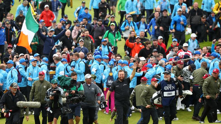 Shane Lowry is cheered home on the 18th at Royal Portrush