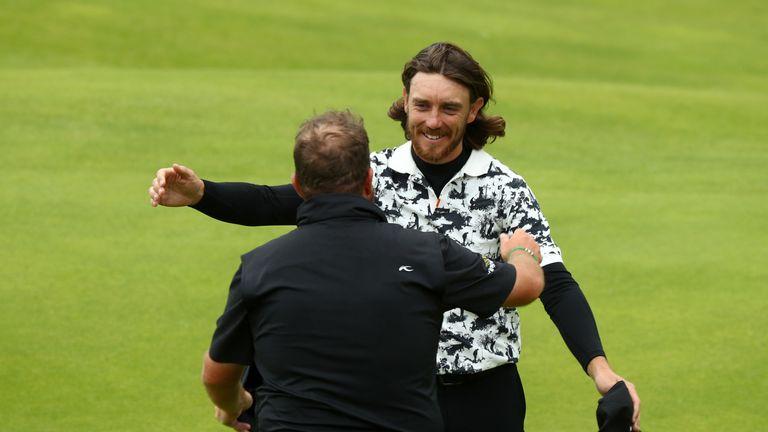 Fleetwood hugs champion Shane Lowry on the 18th green