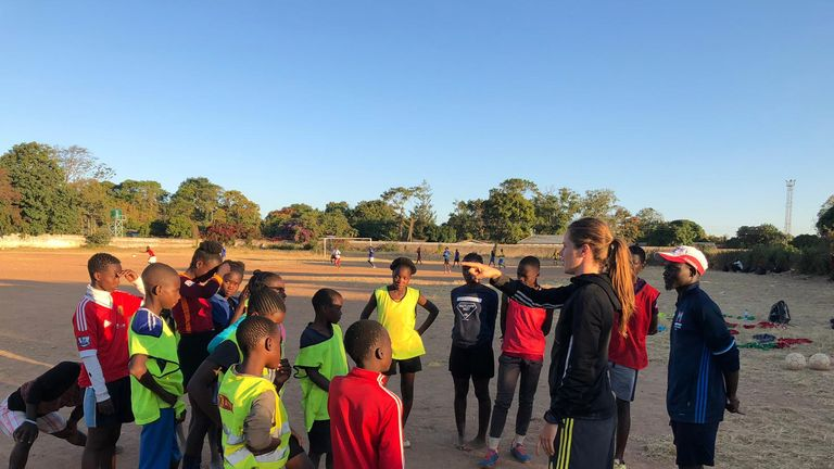 Pedersen coaching youngsters during her summer visit to Zambia