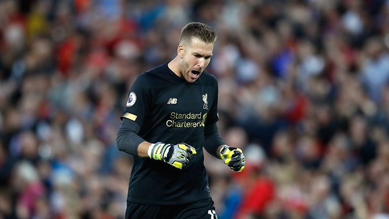 Adrian, a first-half substitute for the injured Alisson, celebrates Liverpool's fourth goal
