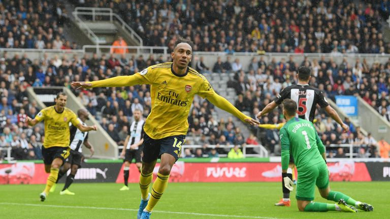 Pierre-Emerick Aubameyang celebrates opening the scoring for Arsenal