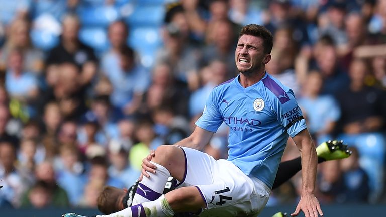 Aymeric Laporte picks up an injury following a challenge with Adam Webster