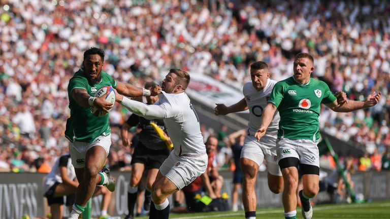 Bundee Aki holds off Elliot Daly to score a late Ireland consolation try