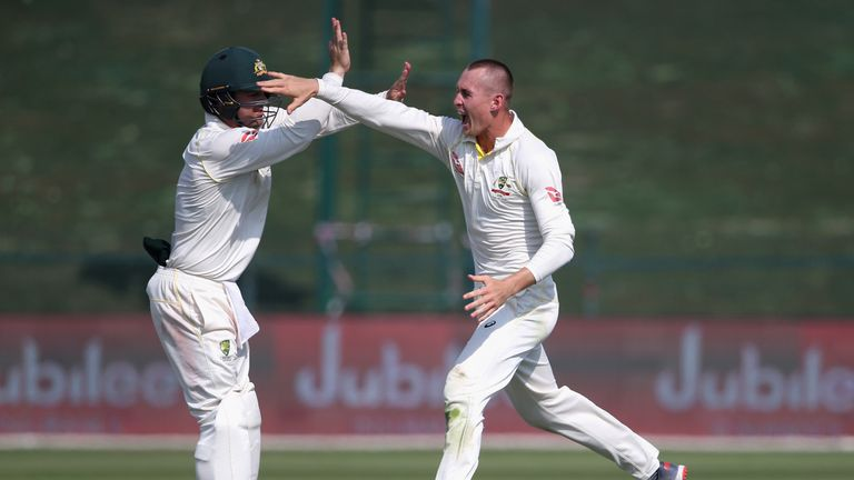 Marnus Labuschagne (right) celebrates a wicket with Australia team-mate Travis Head during the second Test against Pakistan in 2018
