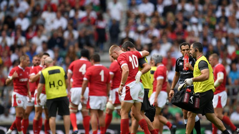 Gareth Anscombe left the field injured during Wales' loss to England on Sunday