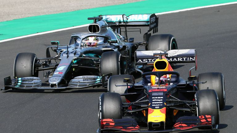 Lewis Hamilton makes a winning pass, overtaking Max Verstappen to claim the Hungarian GP lead - and victory