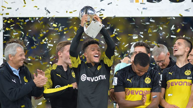 Jadon Sancho raises the DFL Supercup aloft for Borussia Dortmund after his inspired performance against Bayern Munich
