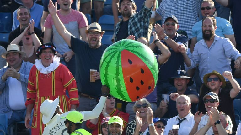 Jofra Archer returns an inflatable watermelon to the stands to the delight of fans