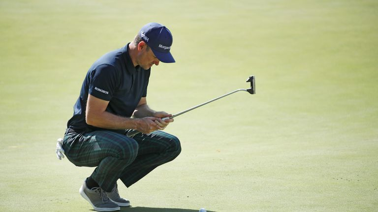 Rose measures up a putt during his second round