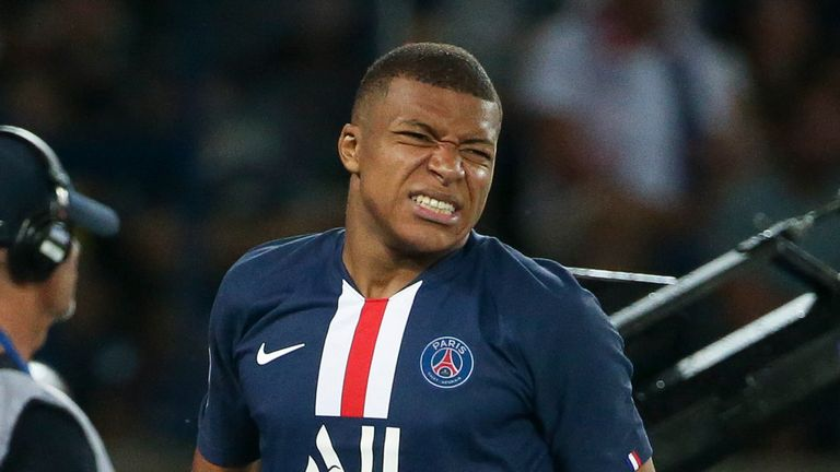Kylian Mbappe winces after injuring his thigh against Toulouse