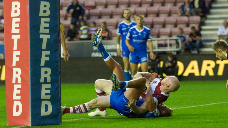 Liam Farrell goes over for Wigan during a fine home Super League victory
