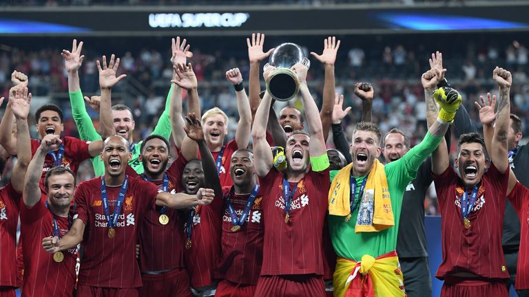 Liverpool celebrate their Super Cup triumph against Chelsea in Istanbul
