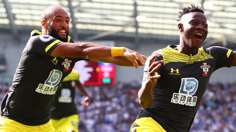 Moussa Djenepo and Nathan Redmond celebrate in Southampton's victory at the Amex Stadium