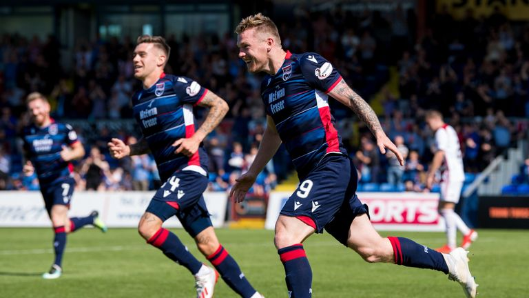 Billy McKay wheels away having made it 2-0 to Ross County
