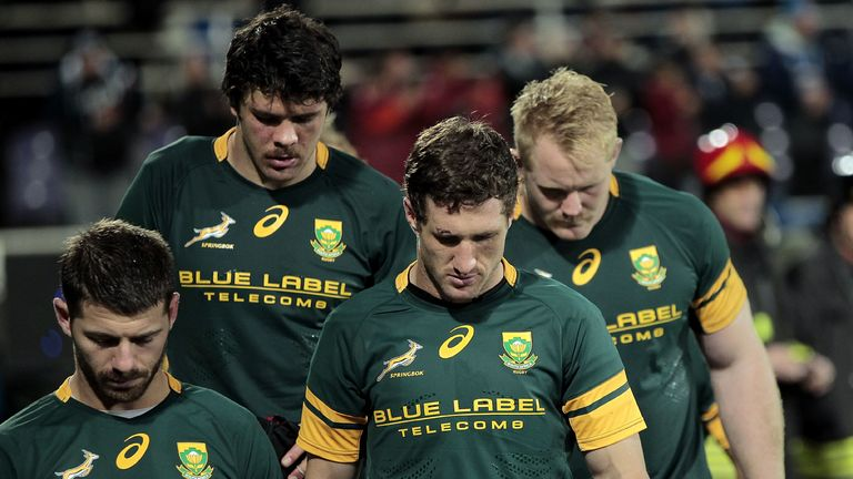 Dejected South African players leave the field after losing to Italy in 2016
