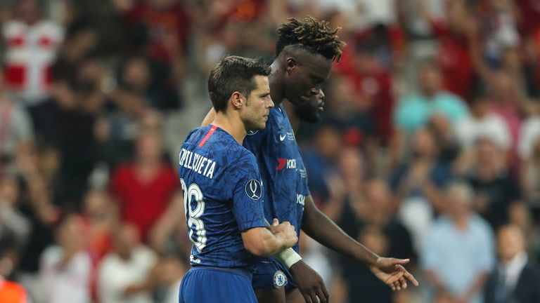 Team-mates console Tammy Abraham after he missed the decisive penalty in the UEFA Super Cup