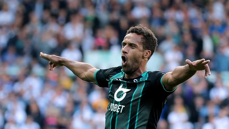 Swansea City's Wayne Routledge celebrates after he scores the winner