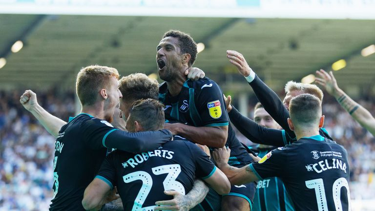 Wayne Routledge celebrates his winner against Leeds with team-mates