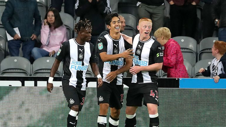 Yoshinori Muto is congratulated after equalising for Newcastle
