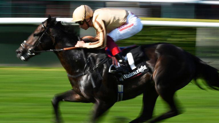 Frankie Dettori riding A'Ali to victory