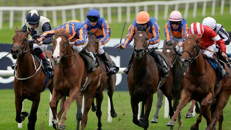 Ryan Moore riding Love (second left, white face) to win the Moyglare Stud Stakes at the Curragh