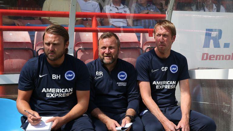 Reid on the Brighton bench alongside Bjorn Hamberg and Graham Potter