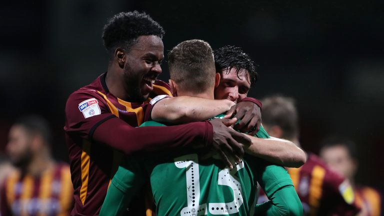 Bradford City's Sam Hornby goalkeeper is congratulated by team-mates after the victory