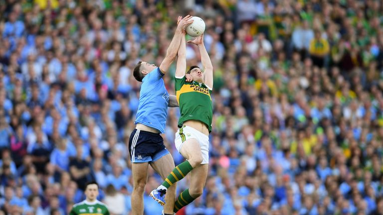 Brian Fenton and David Moran compete for possession