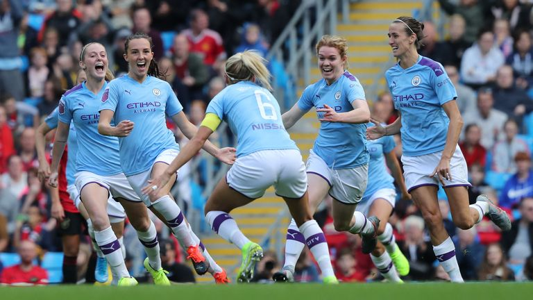 Caroline Weir celebrates firing Manchester City Women into the lead against Manchester United Women